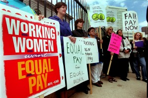 ' Equal Pay Day 2000 ' Rally in front of the U.S Mint, 300 W. Colfax Ave. , Several womens groups speak out about the current wage gap for women and people of colora . smone where carrying red purses to show that women's pay is still in the red, compared